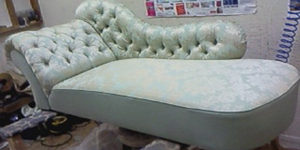 Chaise lounge back to it's former after having it's frame repaired, being traditionally upholstered and <a href=
