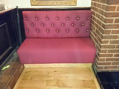 Bench seating upholstered in a red faux leather for the Blind Beggar in Whitechapel