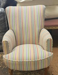 Arm chair we reupholstered in a striped fabric for a client in Bethnal Green