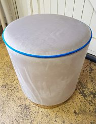 Round footstool we upholstered in a velvet fabric for a bar in Central London