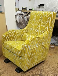 Arm chair we upholstered in a striped fabric for a client in Hackney.
