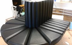 Bespoke bench seating upholstered in black faux leather for a client in East London